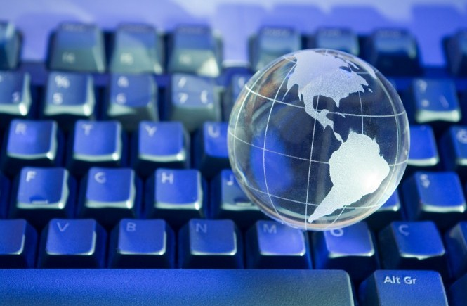 Glass world globe on keyboard