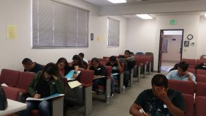 Prospective interpreters doing a mock exam of the written portion of the California Court Interpreter test.